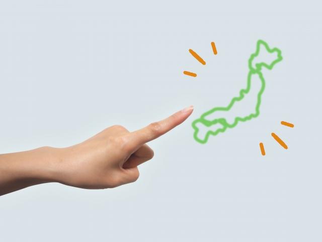 日本地図の絵を指を指す